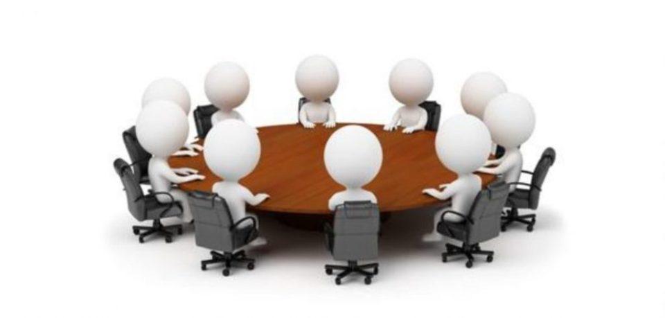 Disegno figure stilizzate persone attorno a un tavolo